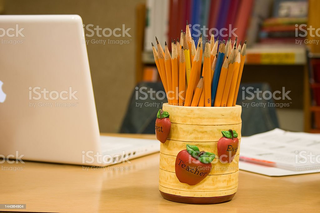 Teacher's Desk with Laptop and Pencils royalty-free stock photo