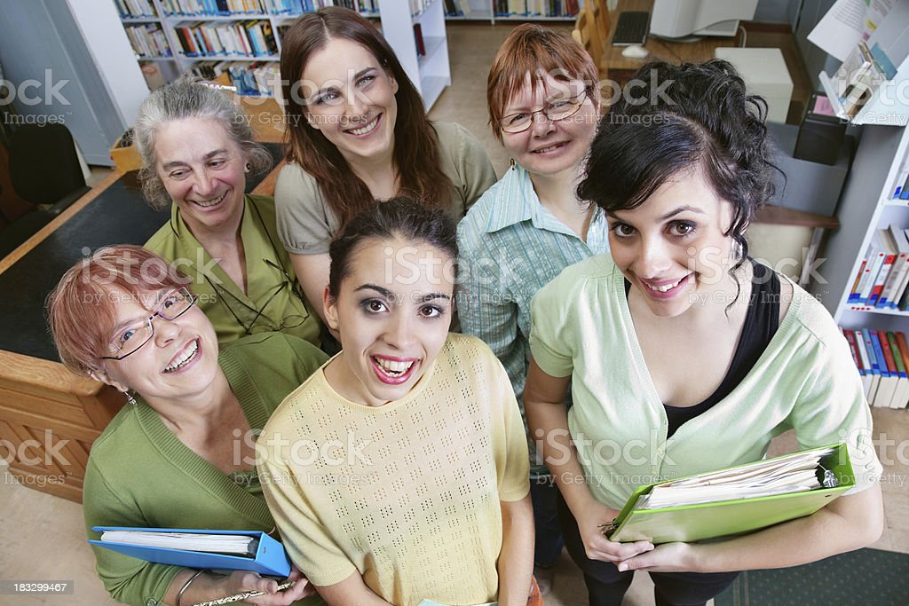 Teachers Looking Up While in School Library royalty-free stock photo