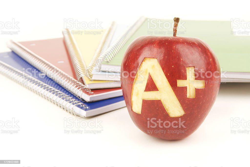 Teachers Pet Apple A+ Plus with Spiral Notebooks School Supplies royalty-free stock photo