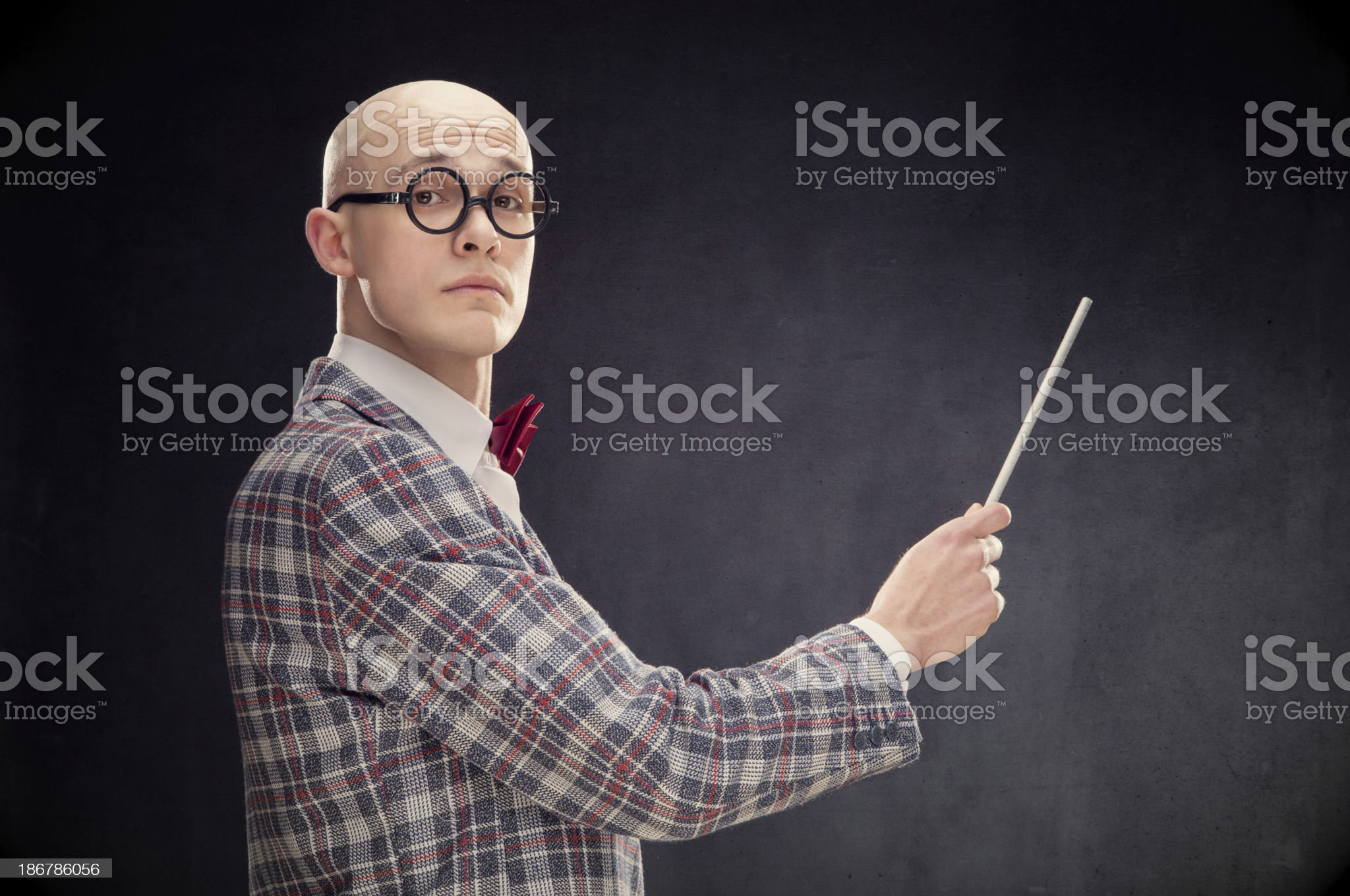 Teaching bald professor with bow tie and wand black isolated royalty-free stock photo