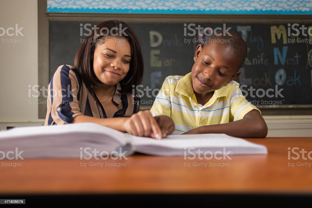 Teaching Child Learning Braille stock photo