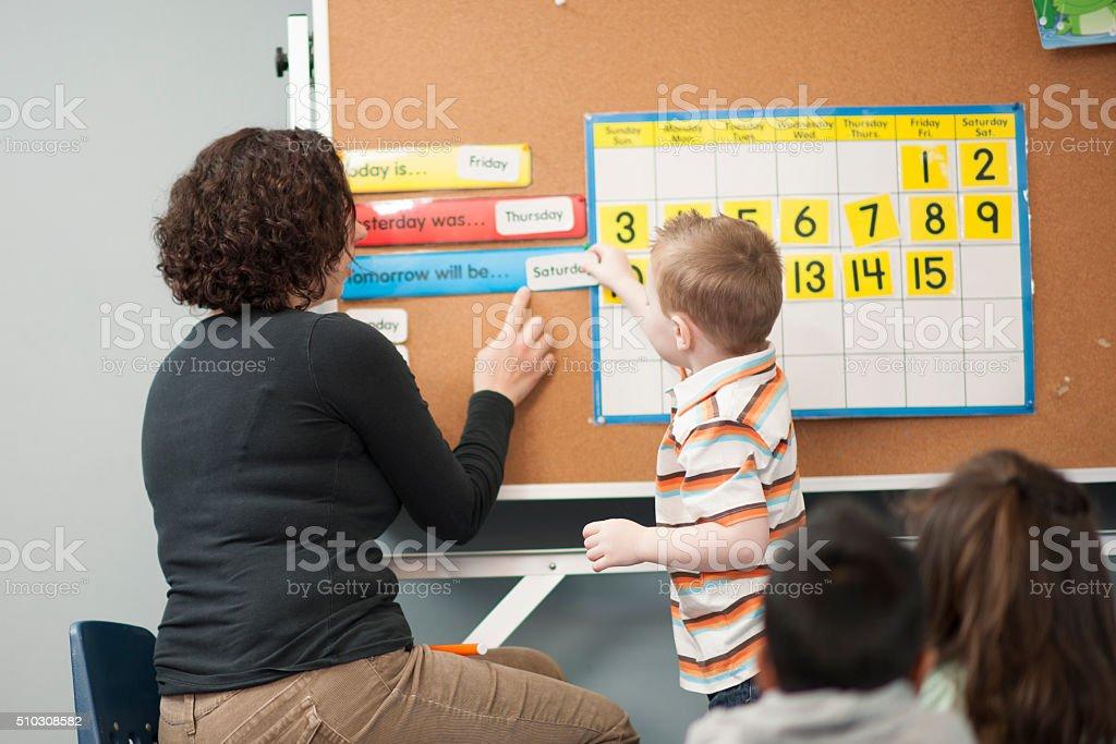 Teaching Children the Days of the Week stock photo