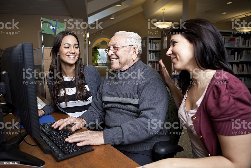Teaching grandpa how to surf the net royalty-free stock photo