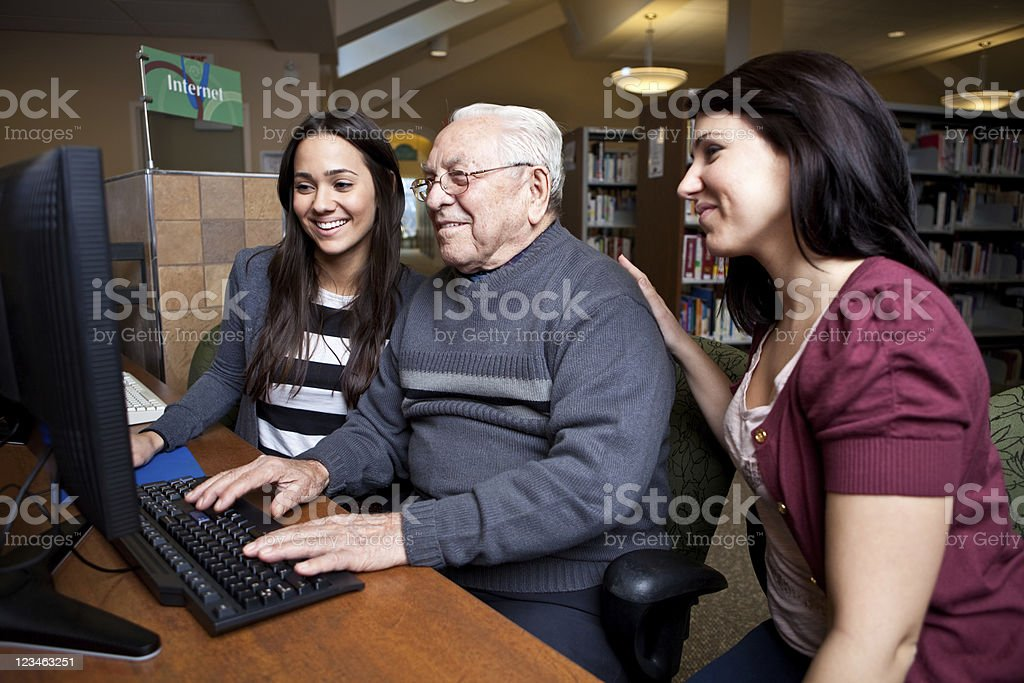 Teaching grandpa how to surf the net stock photo