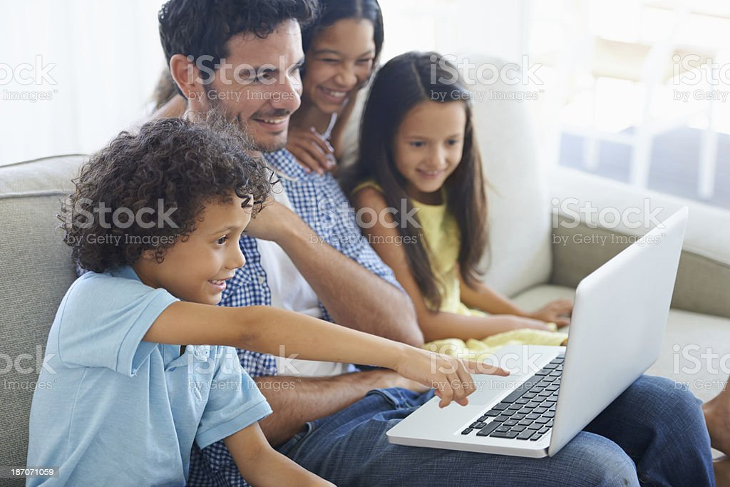 Teaching his kids to surf responsibly stock photo