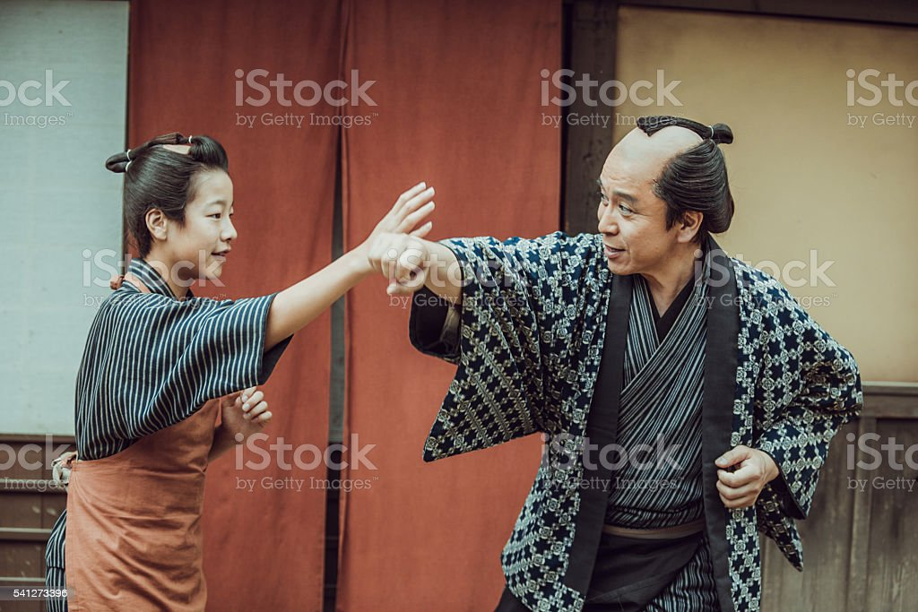Teaching my son self defense. stock photo