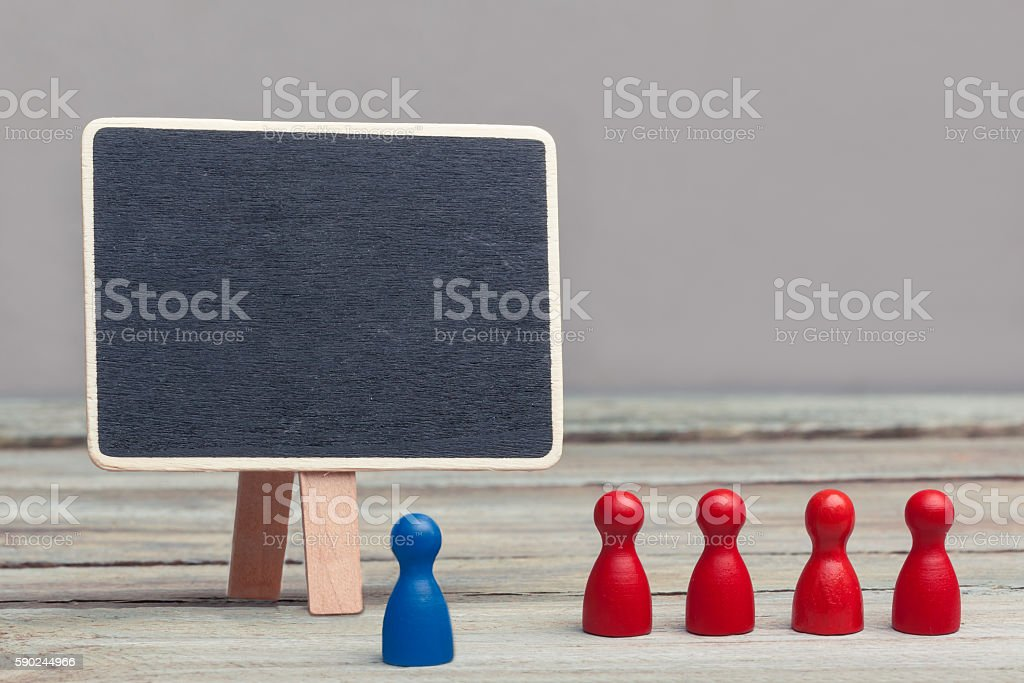 teaching, red and blue wood pieces with copy space chalkboard stock photo