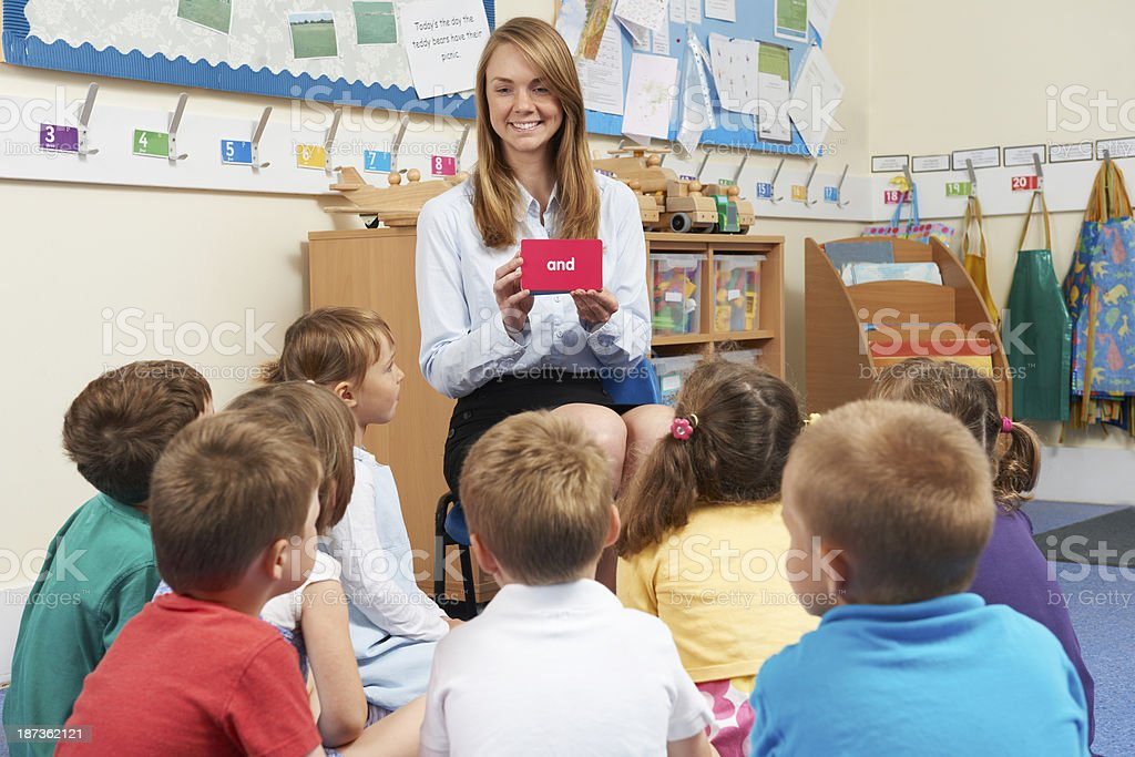 Teaching Showing Flash Cards To Elementary School Class royalty-free stock photo