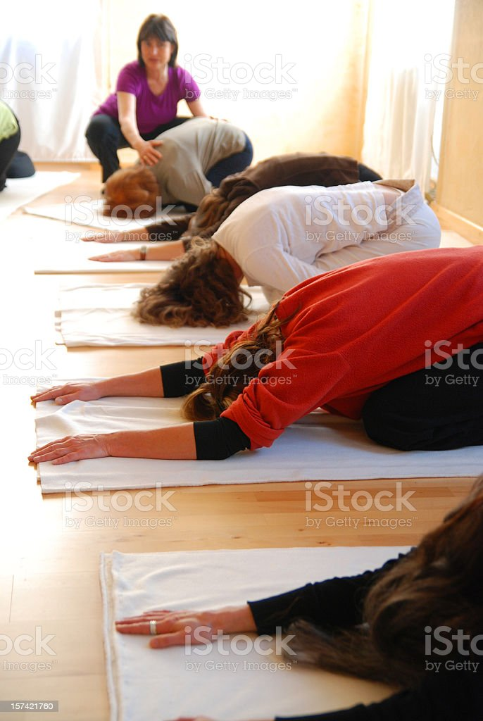teaching yoga group stock photo