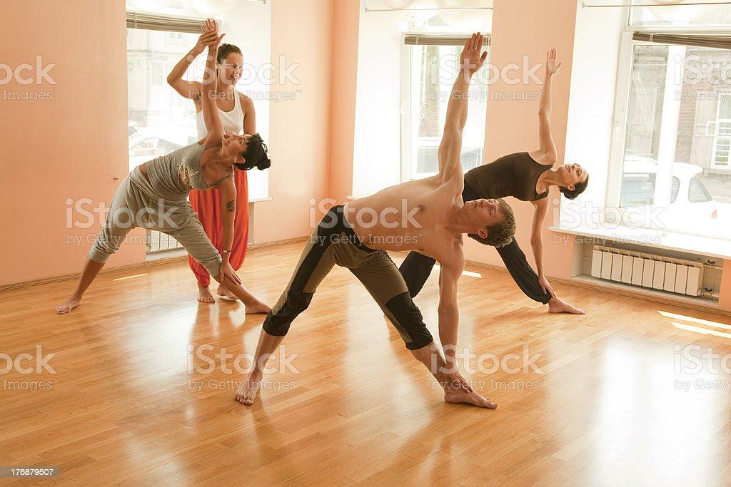Teaching yoga royalty-free stock photo