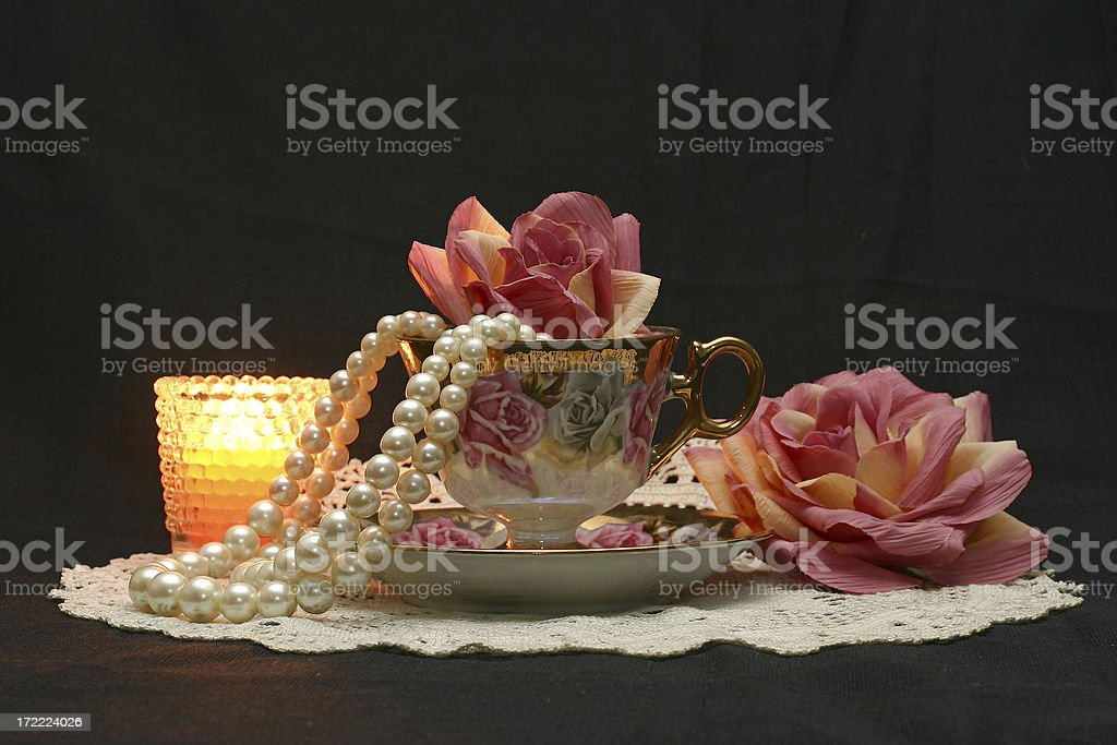 teacup, candle, flowers and pearls royalty-free stock photo