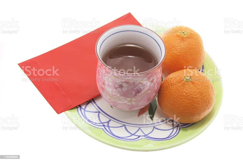 Teacup Mandarins and Red Packet royalty-free stock photo