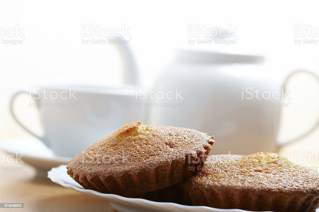 teacup teapot and muffins royalty-free stock photo
