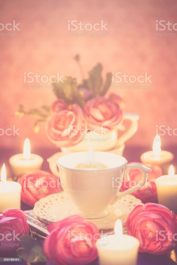 Teacups, Roses and Candleight royalty-free stock photo