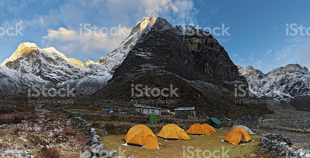 Teahouse camp under Himalaya mountain peaks panorama sunrise stock photo