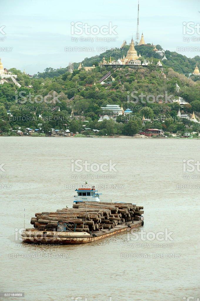 Teak logs in timber on boat in Ayeyarwady river,Myanmar. stock photo