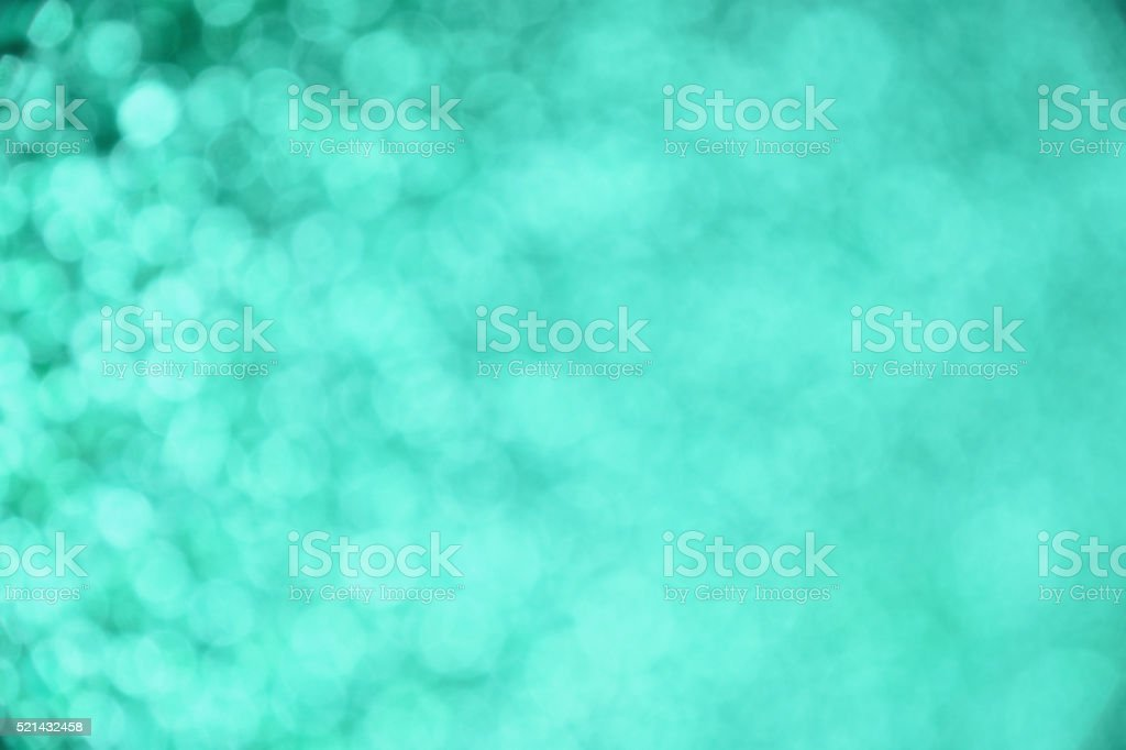 Teal glitter light abstract blur background stock photo