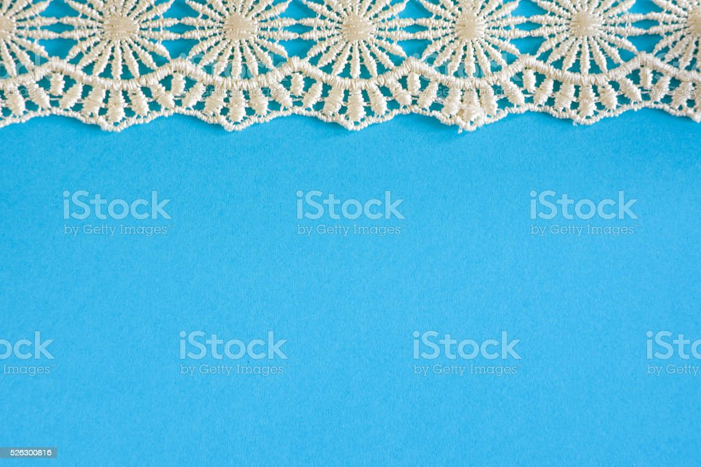 Teal Paper with White Lace stock photo