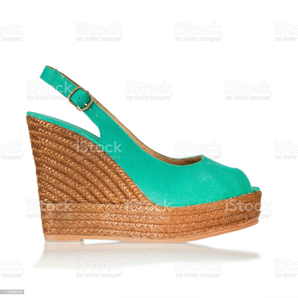 Teal peep-toe, sling-back wedge with natural material  stock photo