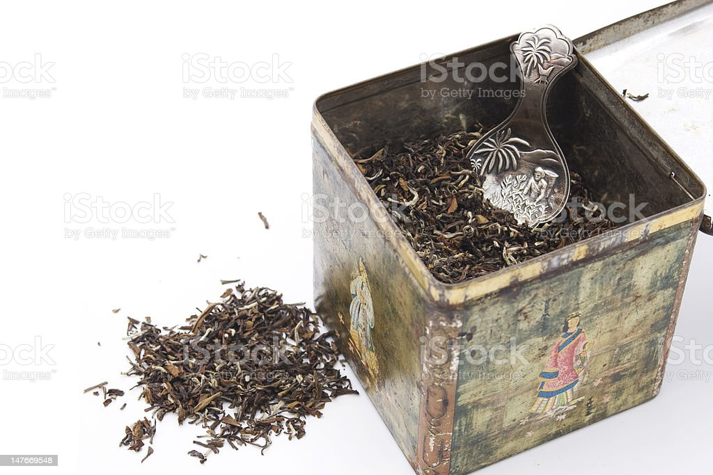 Tealeaves in antique tea box royalty-free stock photo