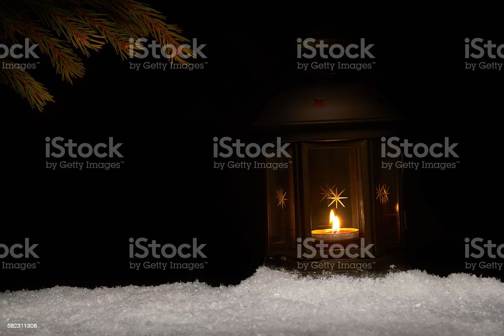 Tealight candle in a festive lantern stock photo