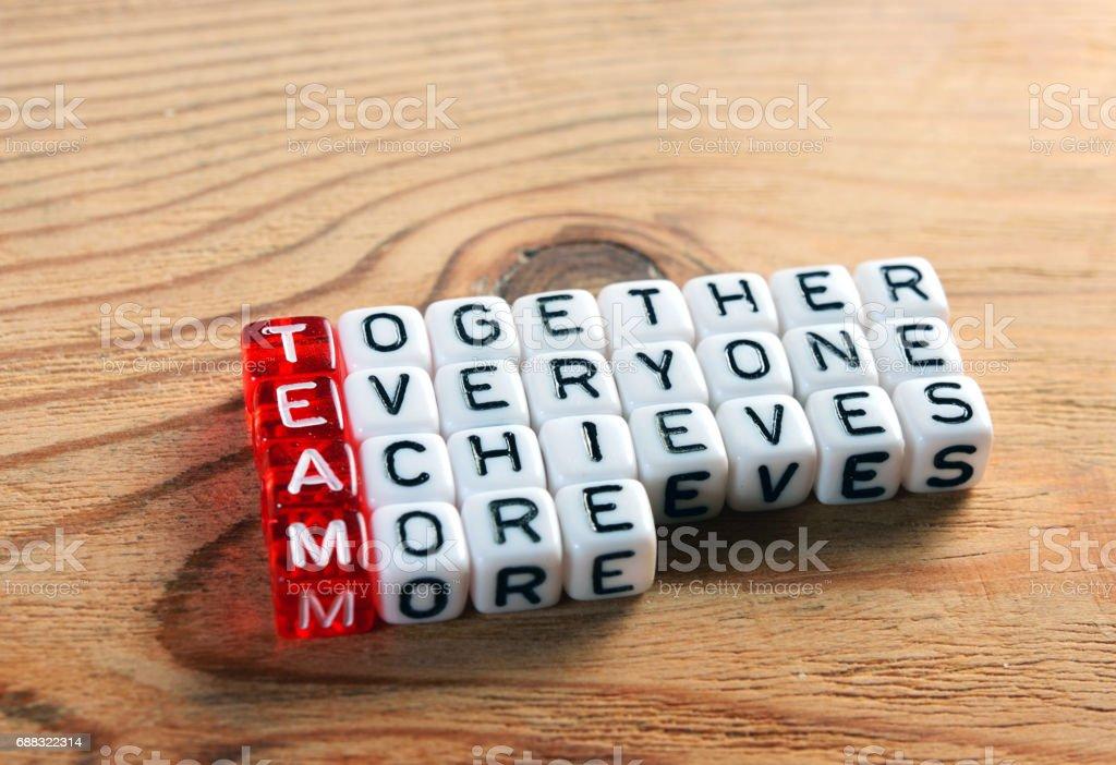 Team acronym on dices stock photo