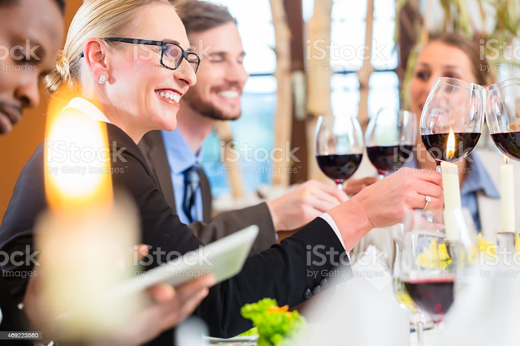 Team at business lunch meeting in restaurant stock photo