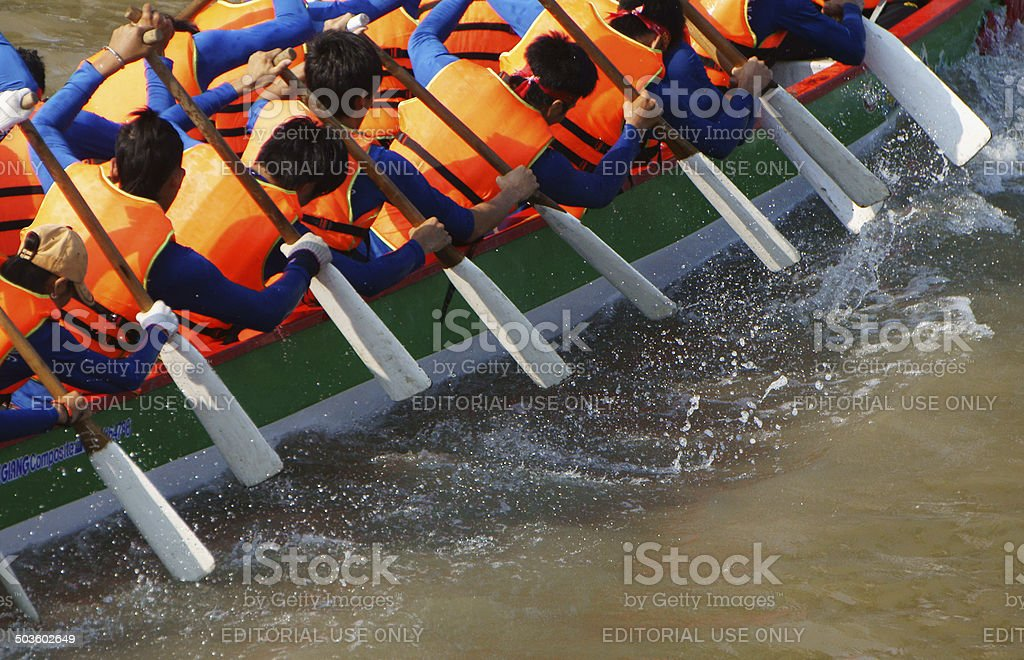 Team building activity,  rowing dragon boat race stock photo