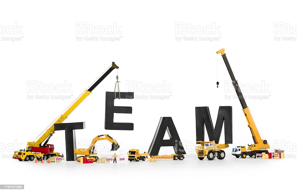 Team building: Machines building team-word. royalty-free stock photo