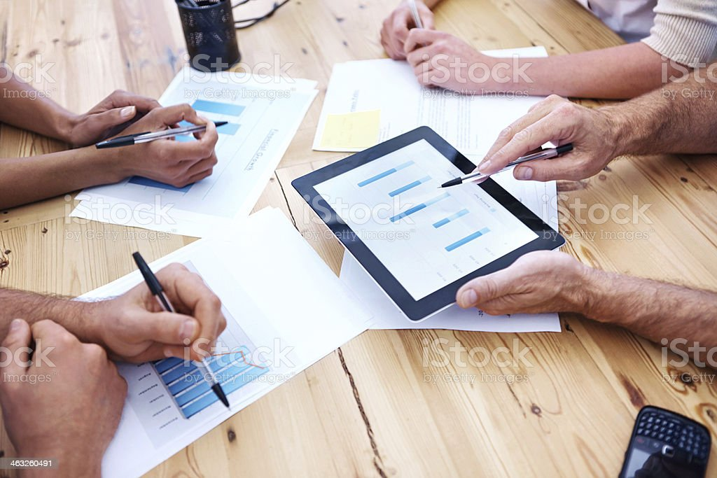 Team business discussion using a tablet stock photo
