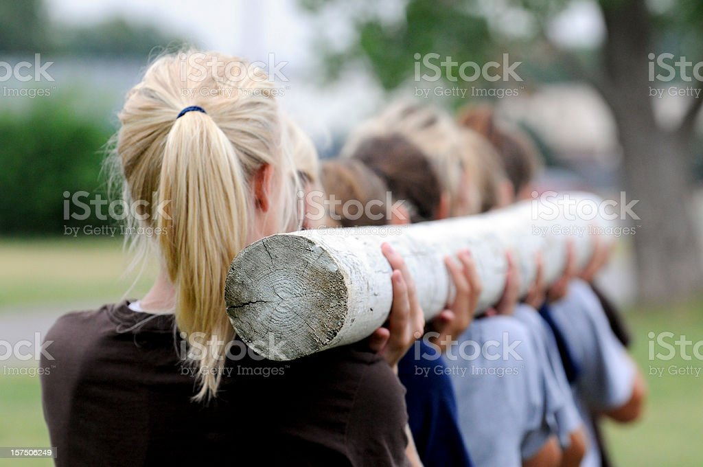 Team carrying pole royalty-free stock photo