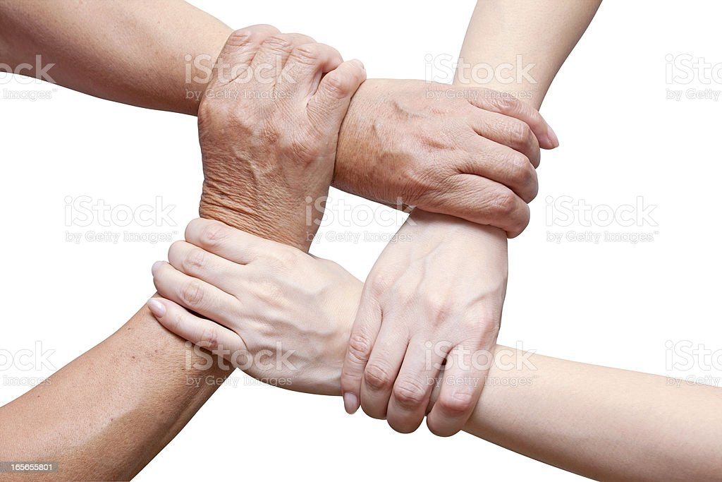 Team concept using joined hands isolated on white (Clipping Path!) stock photo