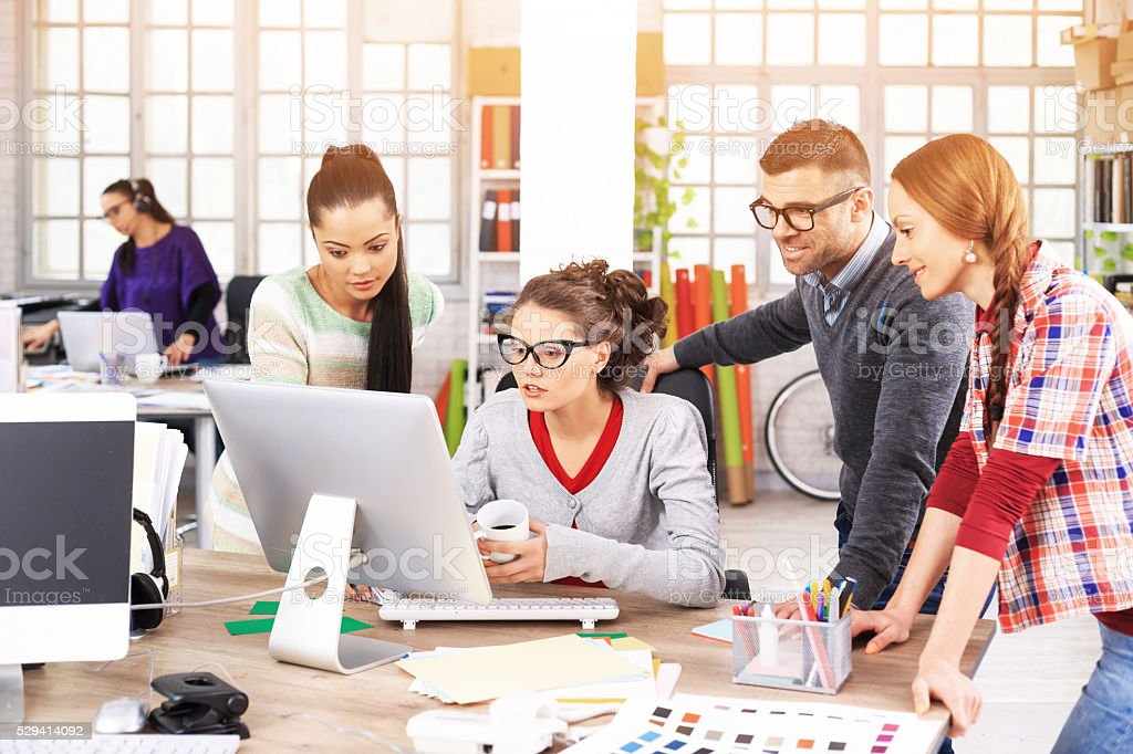 Team designers discussing ideas at the office stock photo