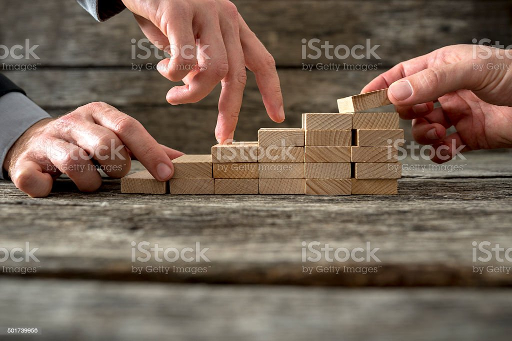 Team effort on the way to success stock photo