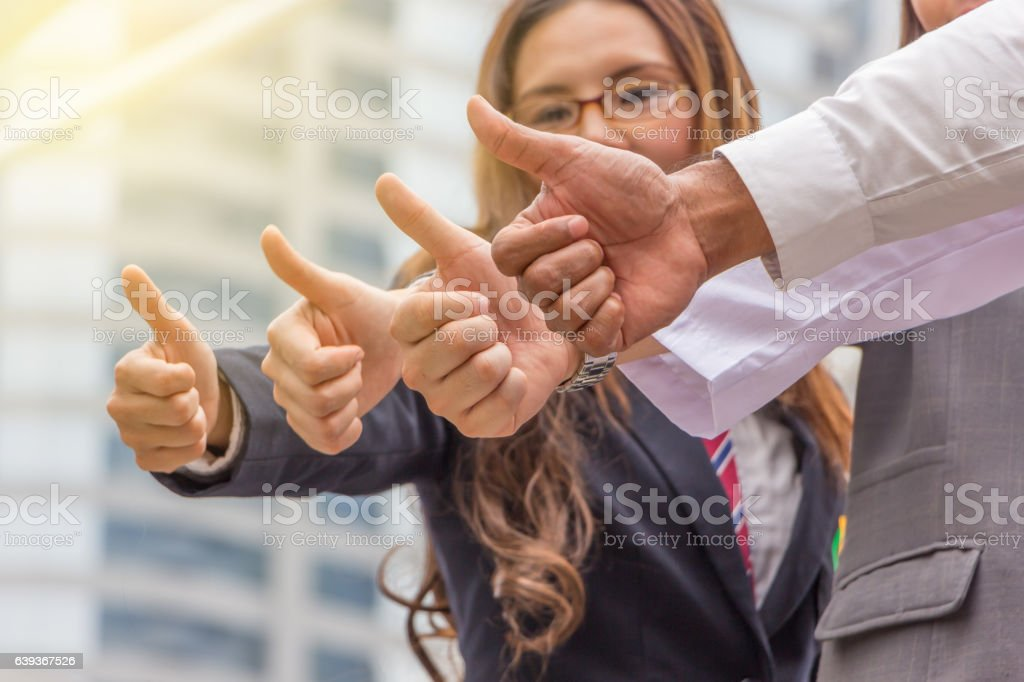 Team giving thumb up sign of Success Business Teamwork Concept stock photo