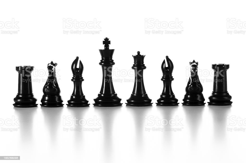 Team, group of black chess pieces in a raw isolated stock photo