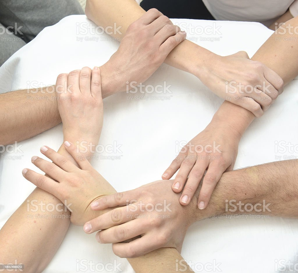Team hands - Hände greifen ineinander im Kreis teamwork royalty-free stock photo