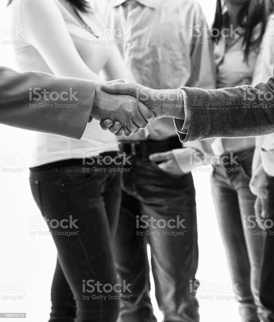 Team Handshaking.Isolated.Black And White royalty-free stock photo