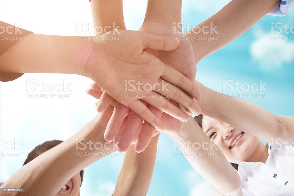 Team join hands partnership concept. stock photo