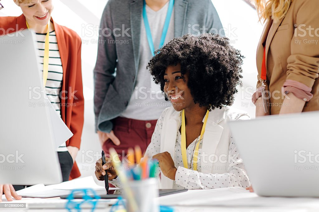 Team Leader Surrounded with her coworkers. stock photo