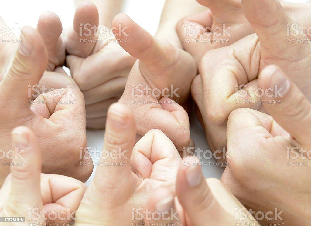 Team many thumbs up stock photo