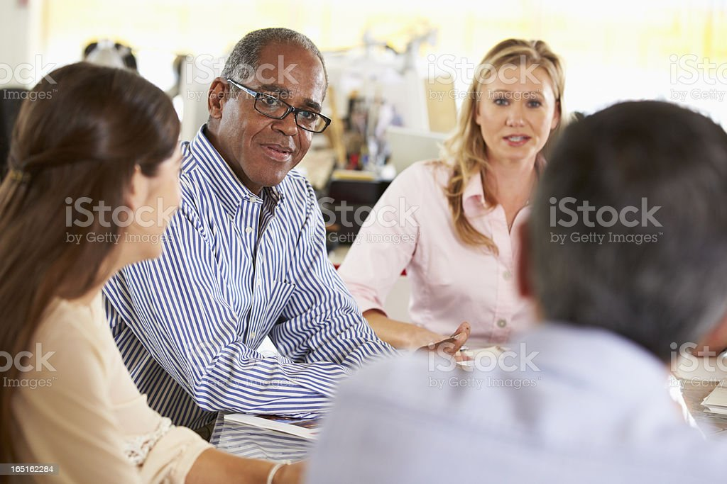 Team Meeting In Creative Office royalty-free stock photo