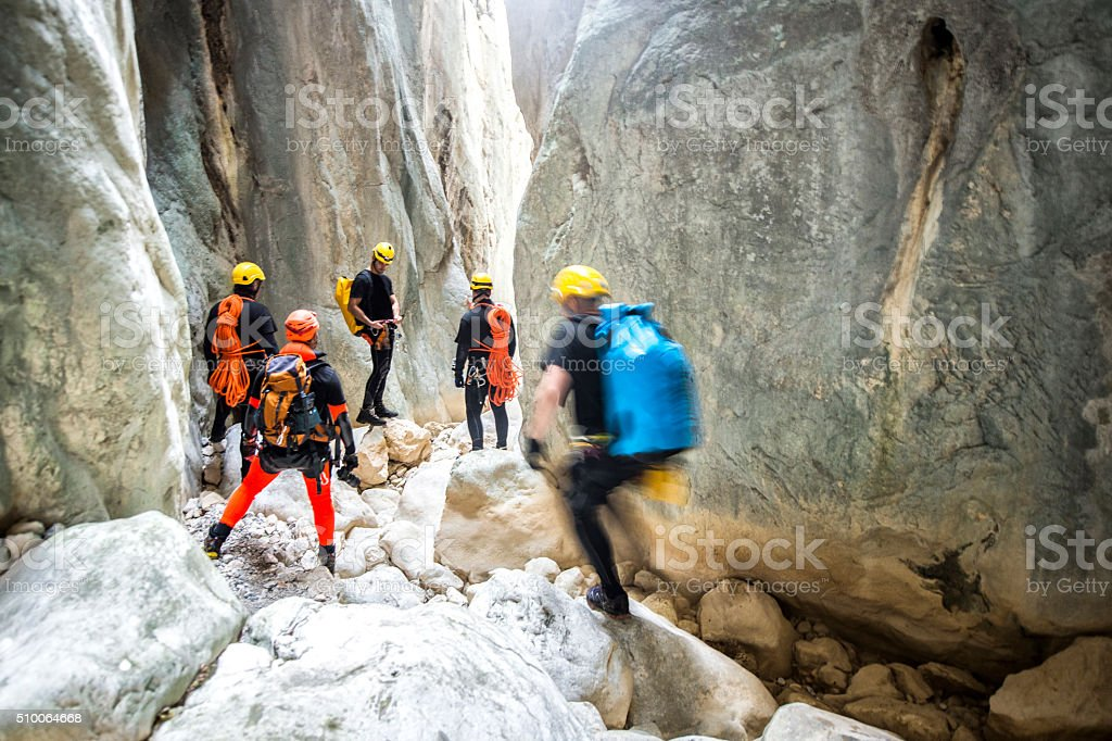 Team members moving through the canyon stock photo