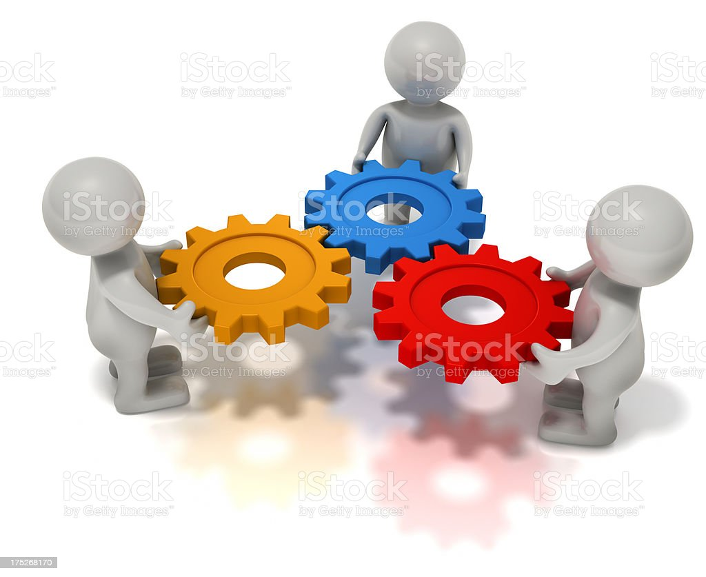 Team members with colorful gears. royalty-free stock photo