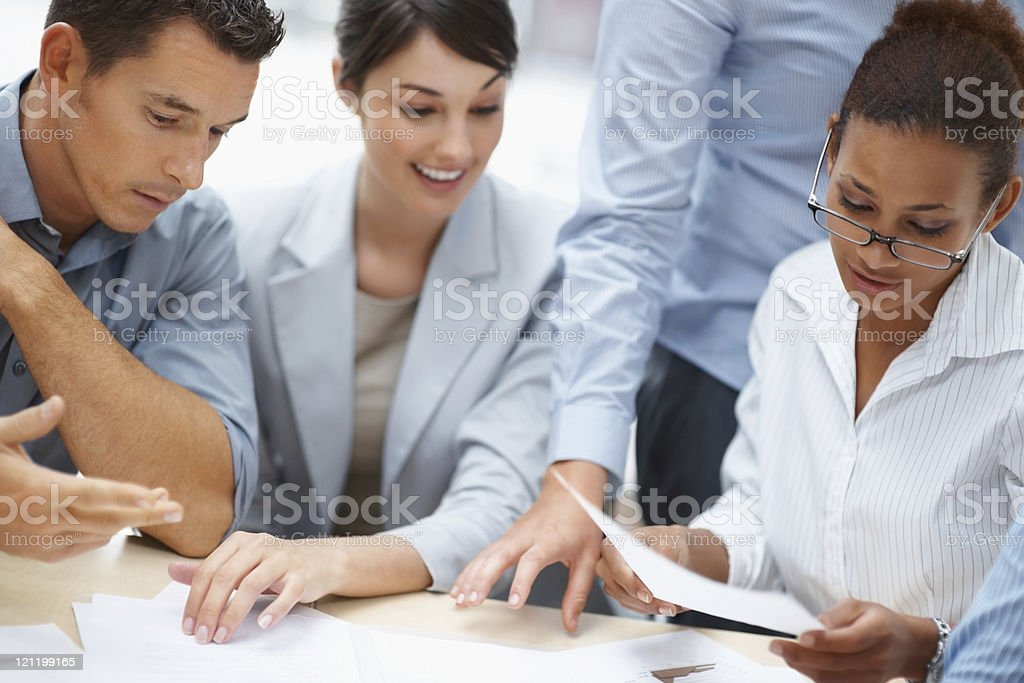 Team of a colleagues working on business plans together royalty-free stock photo