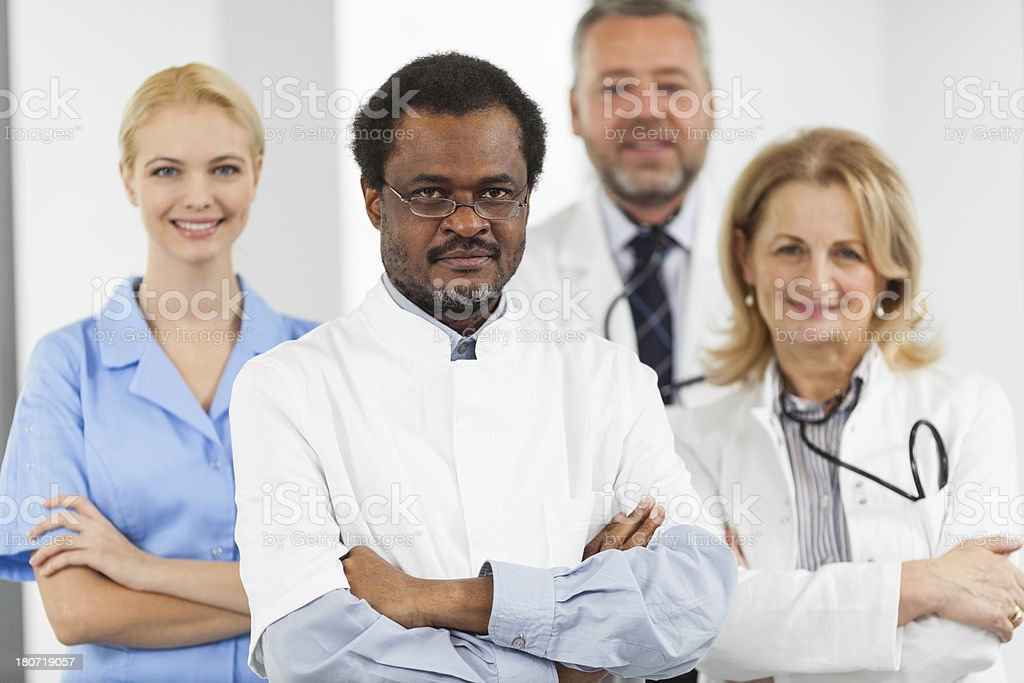Team of a happy doctors standing togeter royalty-free stock photo