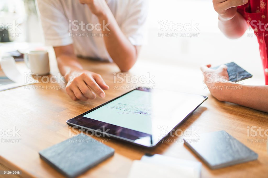 Team of architects having a meeting stock photo