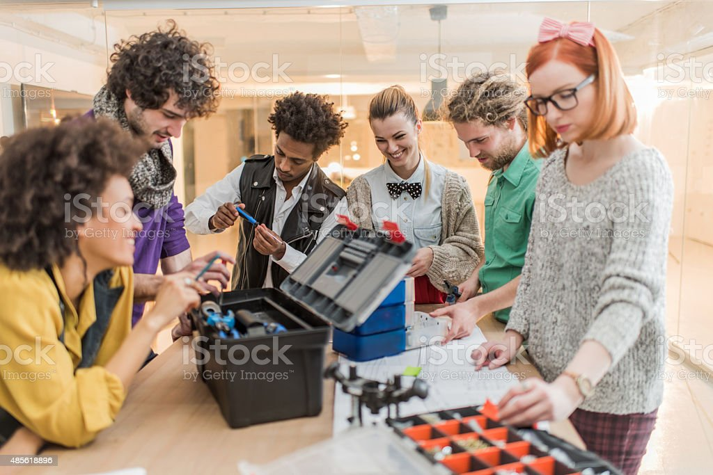 Team of architects in office with architectural tools. stock photo
