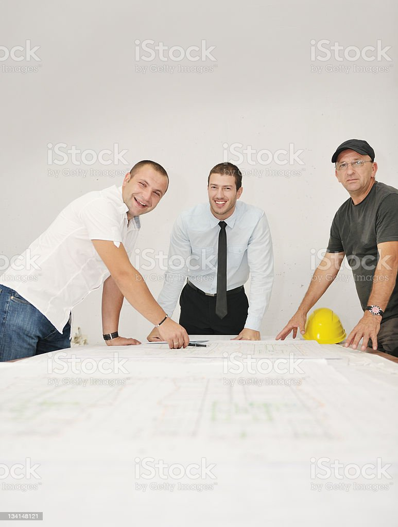 Team of architects on construciton site royalty-free stock photo