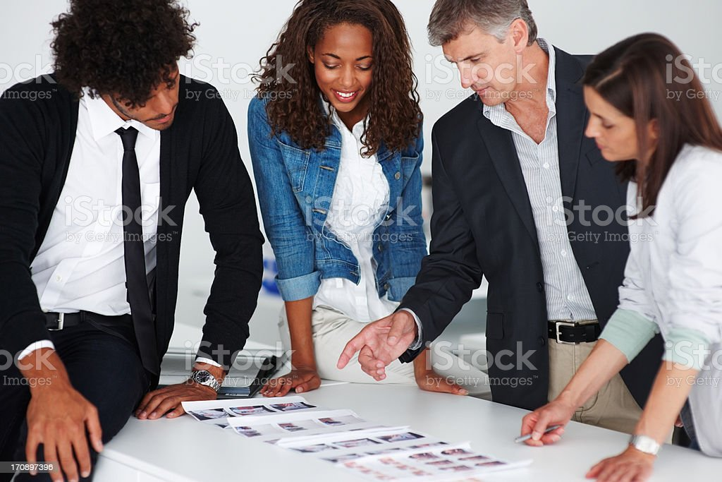 Team of business colleagues working together on a project stock photo